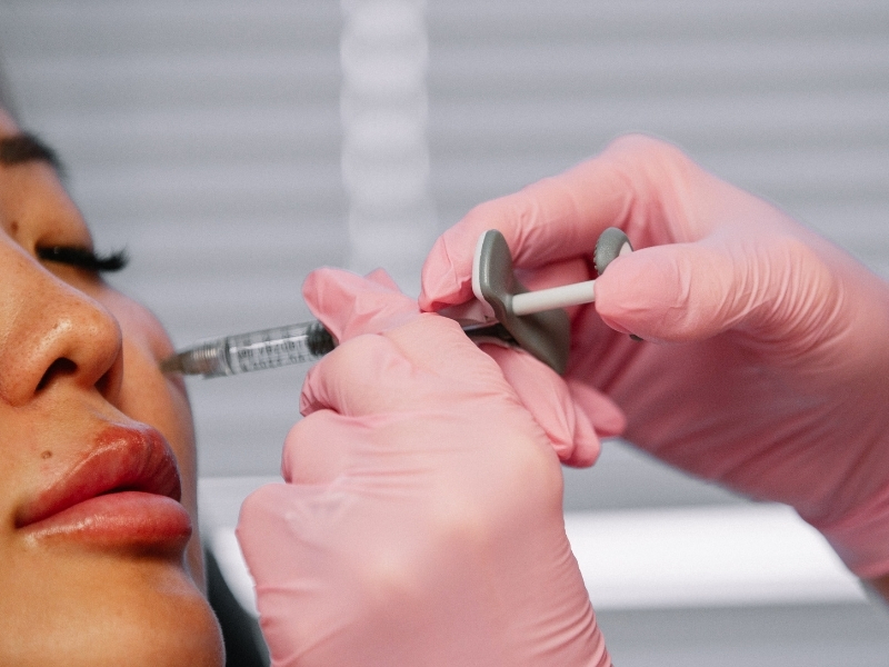 Clean injectable in woman's cheek